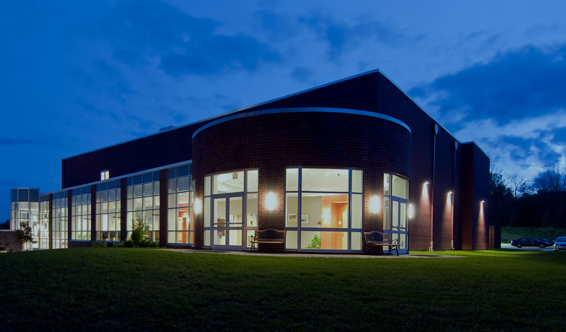 A building on Sussex County Community College's campus in the evening