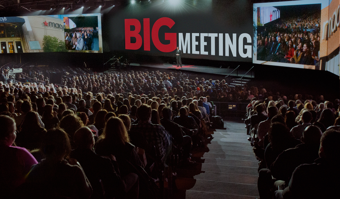 Macy's Big Meeting, an internal meeting held annually for leadership to share vision, strategy, accomplishments, is held in a large auditorium with every seat filled.